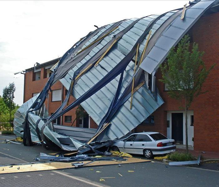Office building with roof damage caused by storm
